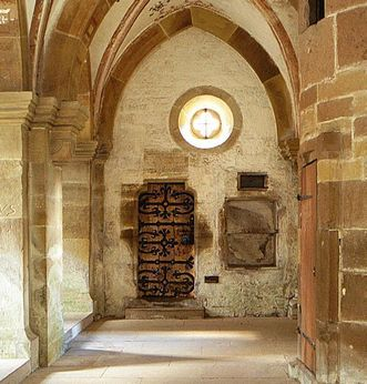 Door of the dead in the south transept at Maulbronn Monastery